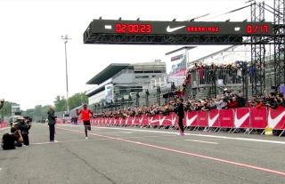 Eliud Kipchoge crosses the finish line with a time of 2:00:25 on May 6, 2017. Kipchoge was one of three athletes who attempted to run a marathon in less than 2 hours as part of Nike's Breaking2 project.