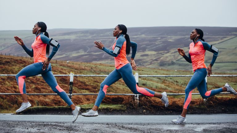 best women's running shoes: Woman running in the countryside