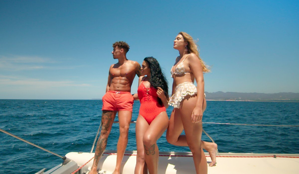 One guy and two girls on a boat Too Hot To Handle Netflix