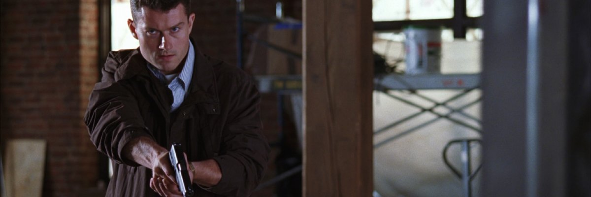 James Badge Dale with Xs in The Departed