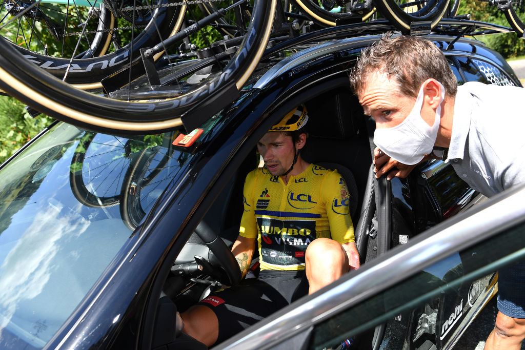 Primoz Roglic got in the JUmbo-Visma team car but then continued in the race