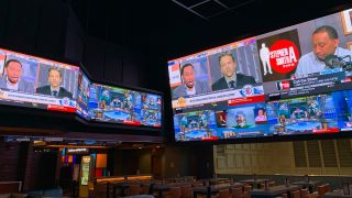 A large-scale video wall at the Tropicana Sportsbook featuring Unilumin displays and Premier Mounts.