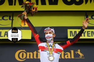 Tadej Pogacar on the podium at the 2021 Tour de France