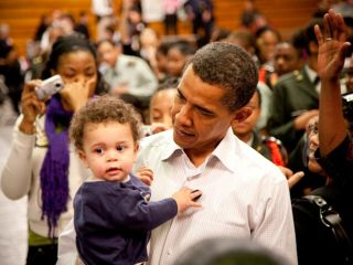 President Obama checks a small child for signs of cyber-infection