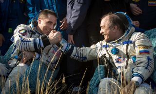 Cassidy Shakes Hands with Vinogradov After Soyuz Landing