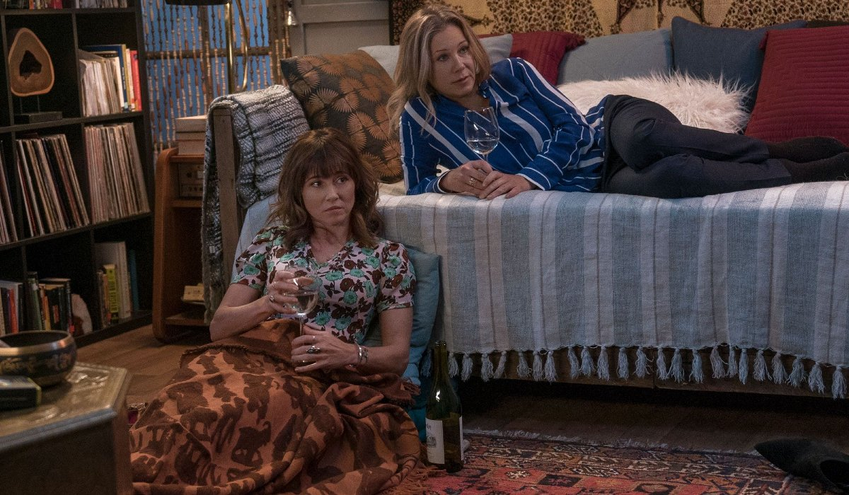 Dead To Me Linda Cardelini and Christina Applegate having a wine and a sleepover
