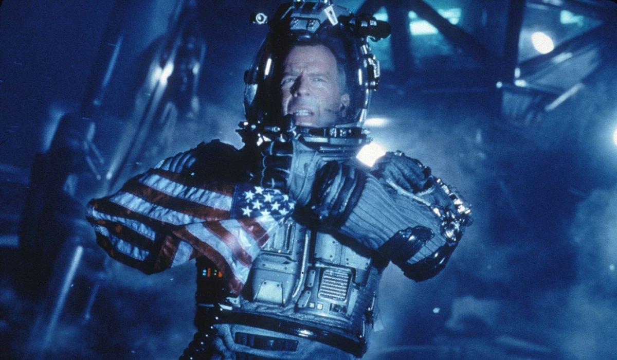 Armageddon Bruce Willis holding the U.S. flag on an asteroid