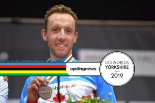 Canada's Michael Woods sports his bronze medal at the 2018 Worlds road race in Innsbruck. Will the less hilly course at the 2019 race in Yorkshire not prove tough enough for him to figure among the medals again?