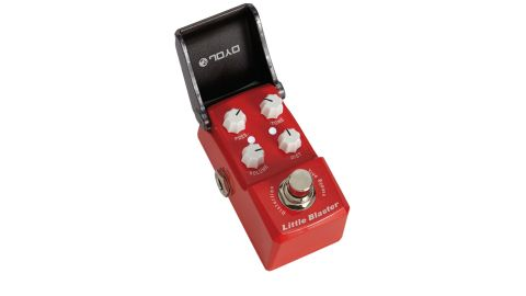 The tiny stompbox comes with a non-slip rubber base and Velcro for attaching to your 'board