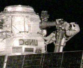 Spacewalking Astronauts Outfit ISS For New Cargo Ship