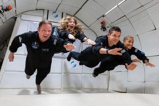 Inspiration4 crew experiences weightlessness during zero-g flight.