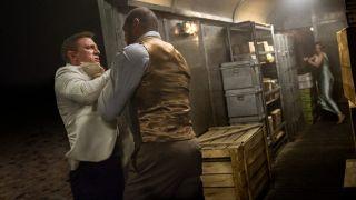 Daniel Craig fighting Dave Bautista as Léa Seydoux takes aim in Spectre.