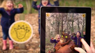 AR app placing the Gruffalo on the screen between two real children
