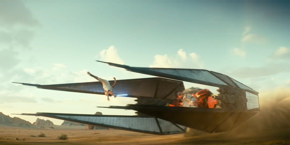 Rey vaulting over Kylo Ren's TIE Fighter