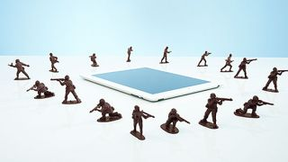 Toy soldiers surrounding the iPad