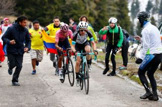 Team BikeExchange rider Great Britains Simon Yates R and overall leader Team Ineos rider Colombias Egan Bernal ride in the final ascent during the 14th stage of the Giro dItalia 2021 cycling race 205km between Citadella and Monte Zoncolan on May 22 2021 Photo by Luca Bettini POOL AFP Photo by LUCA BETTINIPOOLAFP via Getty Images