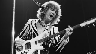 Chris Squire (1948 - 2015) performing with English progressive rock band Yes, at Madison Square Garden, New York, 5th August 1977