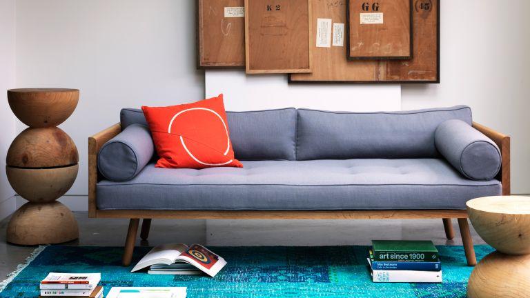 Mid-century modern sofa in grey with cork board wall
