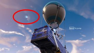 The Fortnite comet just off the side of the battle bus.