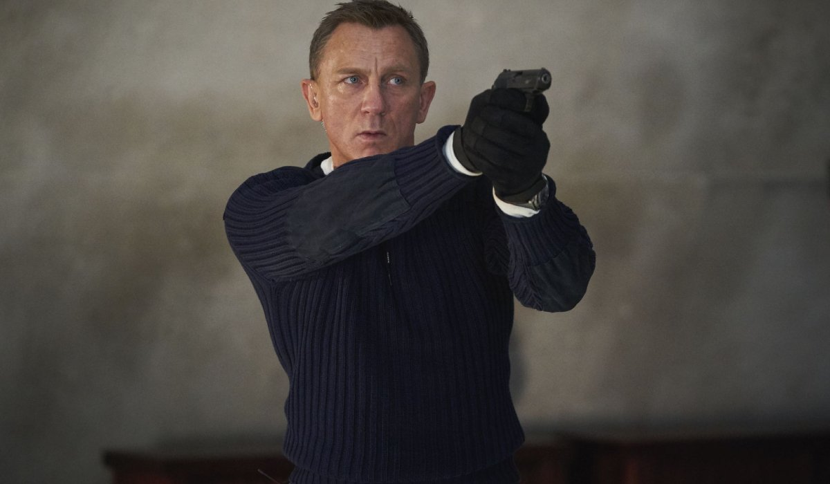 No Time To Die James Bond raises his gun in defense