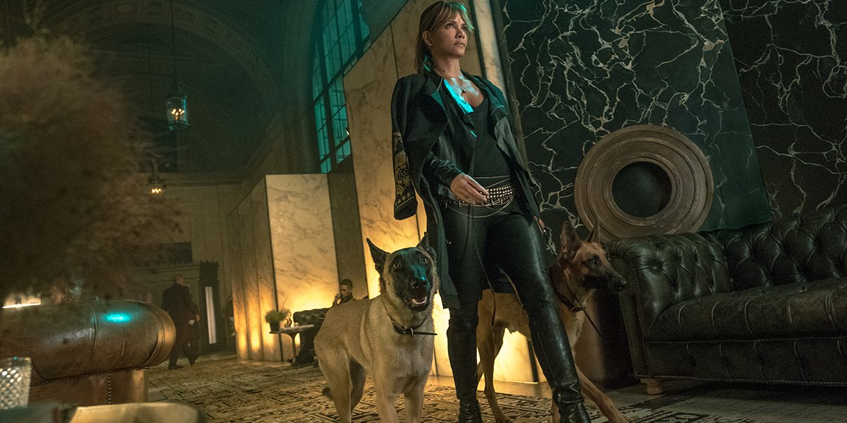Halle Berry as Sofia strutting off with her dogs in John Wick: Chapter 3