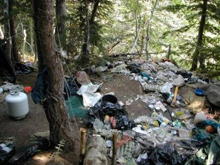 Trash accumulated by growers at a marijuana grow site raided by the U.S. Forest Service and other agency law-enforcement officers