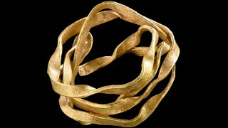 This gold artifact, which may have been used as a hair ornament, was found buried with a woman who died around 3,800 years ago.