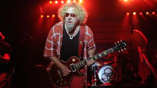 Sammy Hagar playing guitar onstage