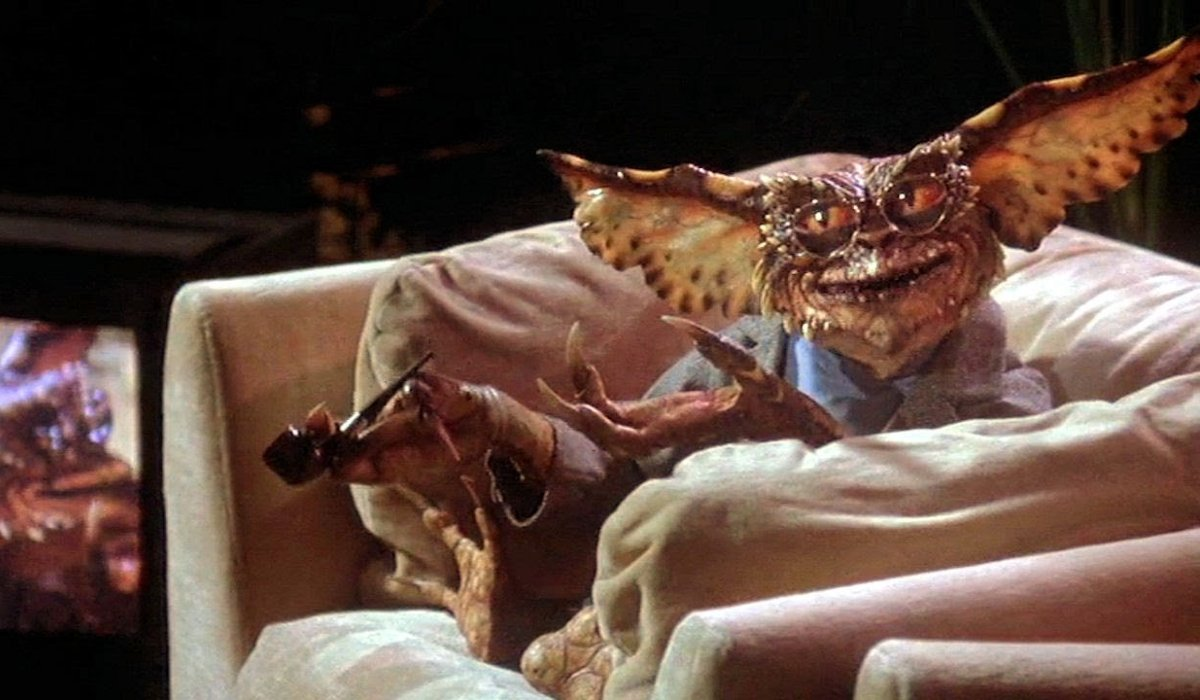 Gremlins 2: The New Batch Brain Gremlin hosts from a chair