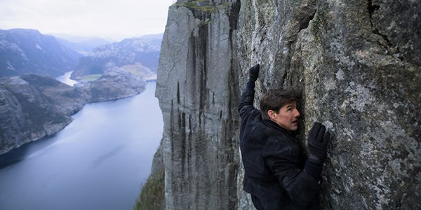 Ethan Hunt hanging on to a cliff in Mission: Impossible Fallout