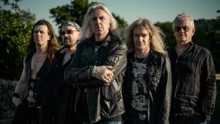 A picture of Nigel Glockler with Saxon