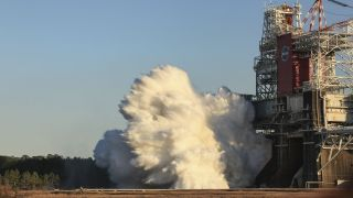 The core stage for the first flight of NASA's Space Launch System, or SLS, rocket is seen in the B-2 Test Stand during a hot fire test, Saturday, Jan. 16, 2021, at Stennis Space Center near Bay St. Louis, Mississippi. The four RS-25 engines fired for a little more than one minute and generated 1.6 million pounds of thrust. The hot fire is part of the Green Run test series, a comprehensive assessment of the Space Launch System's core stage prior to launching the Artemis I mission to the Moon.