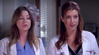 Meredith and Addison look at a patient.
