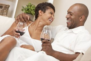 Happy couple drinking wine.