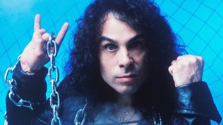 Heavy metal singer Ronnie James Dio holding up chains against a blue background