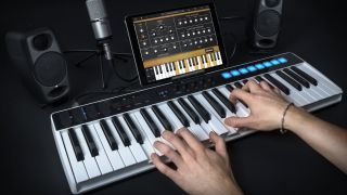 Musician playing a IK Multimedia keys I/O into an iPad