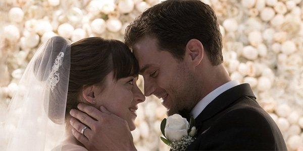 fifty Shades Jamie Dornan and Dakota Johnson laughing during wedding scene.