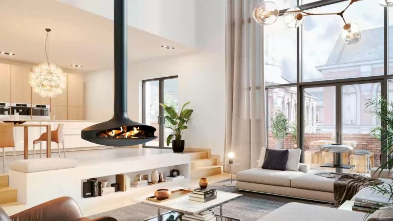 Gyrofocus Modern fireplace in an open plan kitchen living space by Focus Fireplaces