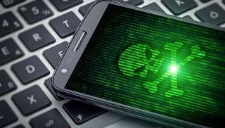 Smartphone displaying skull and crossbones on screen.