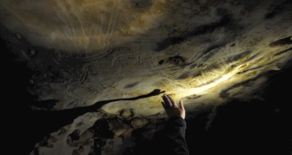 Hand fluting in the Cave of a Hundred Mammoths in France.