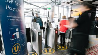 Passengers using face ID security gates at an airport