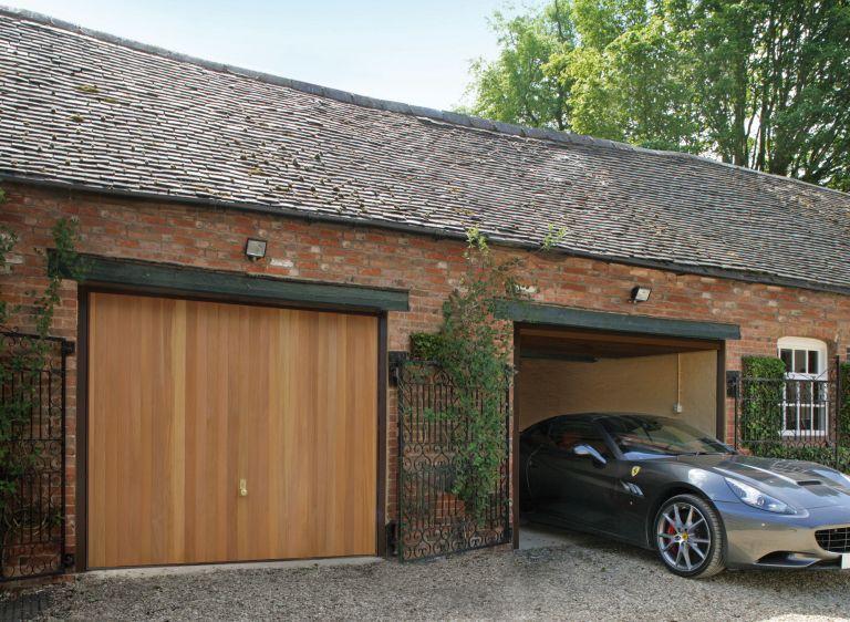 Timber garage door on gravel driveway of barn