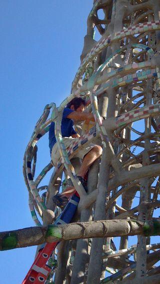 Ertugrul Taciroglu climbing the central tower of Watts Towers