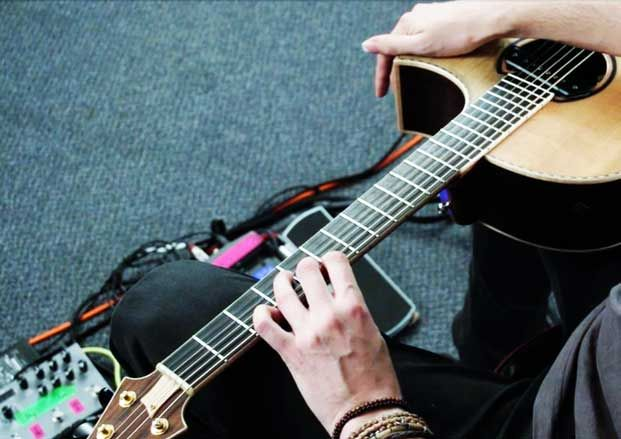 How to play guitar on your lap using two-hand tapping