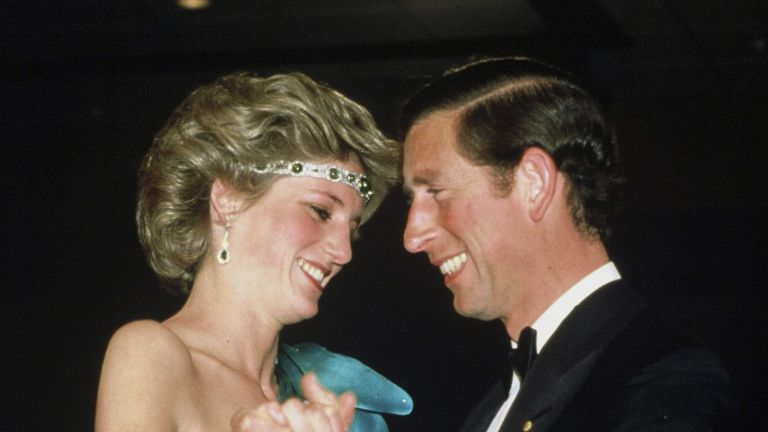 Princess Diana angered the Queen: Prince Charles, Prince of Wales and Diana, Princess of Wales, wearing a green satin evening dress designed by David and Elizabeth Emanuel and an emerald necklace as a headband, dance together during a gala dinner dance at the Southern Cross Hotel on October 31, 1985 in Melbourne, Australia