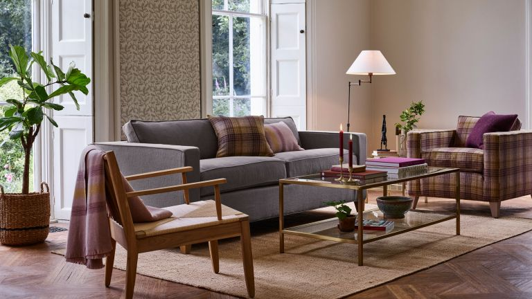 living space with sofa, coffee table and rug