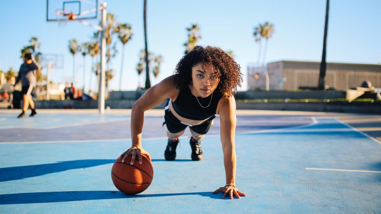 Doing a HIIT workout with a basketball