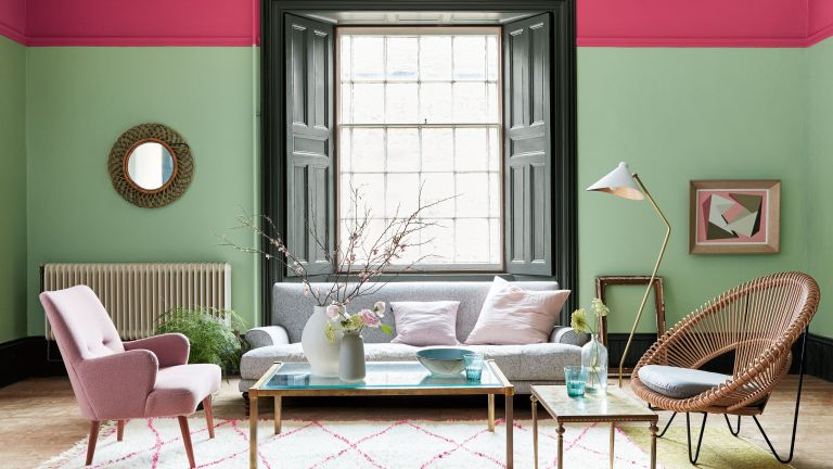 Abstract living room with pink and green walls and stripy carpet