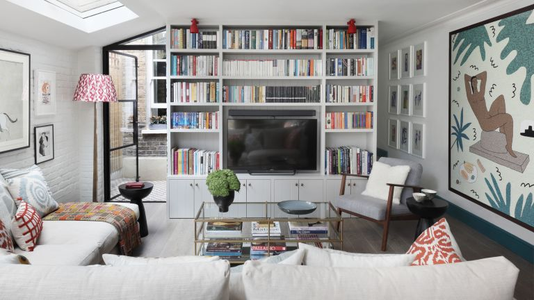 Living room showing a library of books with a TV inset into the picture