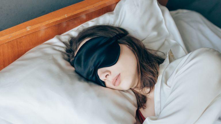 woman sleeping in a silk eye mask on